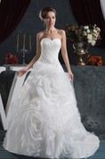 Sweetheart Criss-Cross Ball Gown with Ruffled Skirt and Stress