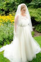 Jewel Sleeveless Long Tulle Wedding Dress With Sash And Crystal Detailing