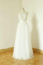 Bateau Sleeveless Low-V Back Tulle Wedding Dress With Sash And Appliques