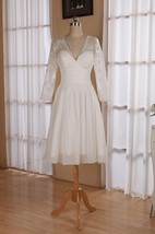 V Neck 3 4 Length Sleeve Chiffon Wedding Dress With Ruching And Illusion Back