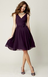 Knee-Length Sleeveless Criss-Cross V-Neck Chiffon Bridesmaid Dress With Bow