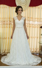 Lace Overlaying A-Line Wedding Gown With See Through Back