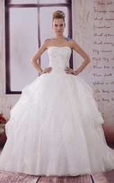 Strapless Appliqued Ball Gown with Ruching and Corset Back