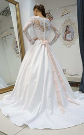 Bateau Illusion Long Sleeve Satin A-Line Wedding Dress With Bow And Sweep Train