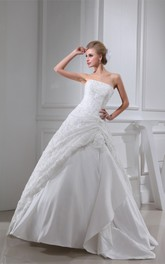 Strapless Appliqued Ball Gown with Ruching and Side Draping