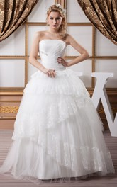 Strapless Tulle Ball Gown with Peplum and Appliques