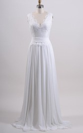 Sleeveless Alencon Lace Bridal Gown With Low-V Back and Chiffon Skirt.