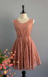 Sleeveless Lace Dress With Low-V Back And Bow