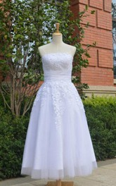 Strapless Button Back Tea-Length Satin Wedding Dress With Appliques And Ruching
