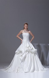 Ruched Criss-Cross Strapless Bodice Gown with Ruffles and Embellishment