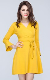 Gold Surplice Neck Bell Sleeve Mini Dress