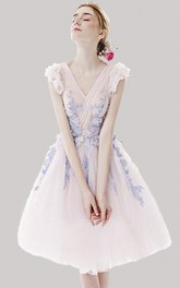 Romantic Floral Appliqued Tulle Knee Length Dress With Criss Cross And Cap Sleeves