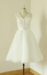 V-Neck Sleeveless Organza Wedding Dress With Sash And Low-V Back