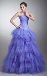 strapless tiered ball a-line criss-cross gown with ruffles
