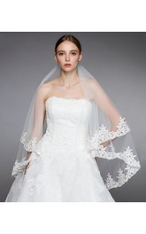Elegant Two Layer Fingertip Veil With Trailing Lace