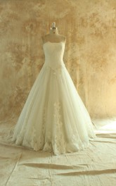 Strapless Long Tulle Wedding Dress With Appliques And Lace-Up Back