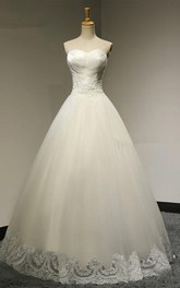 A-line Floor-length Organza Wedding Dress With Ruching And Appliques