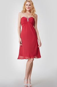 Sleeveless Empire Waist Knee Length Chiffon Dress With Beaded Detail