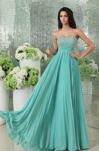 Pleated Empire Soft Flowing Fabric Gown With Sequined Bodice
