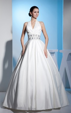 Plunged Sleeveless Ball Gown with Central Ruching and Gemmed Waist
