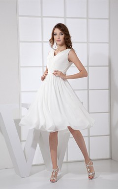 Sleeveless Low-V-Back Knee-Length Dress with Ruching and Pleats