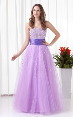strapless a-line tulle dress with ruched waist and jeweled top