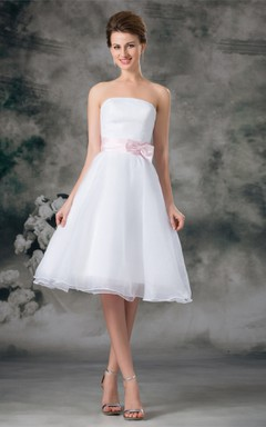 strapless tea-length a-line dress with zipper back and bow