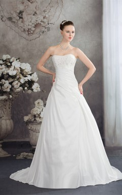 Strapless Appliqued Ball Gown with Beading and Ruching