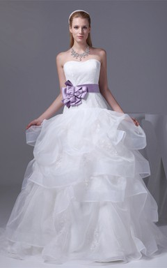 Strapless Ruffled Ball Gown with Bow and Appliques