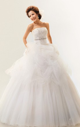 Intricate Strapless Ruffled Ball Gown With Crystal Detailing ...