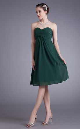 Elegant Soft Flowing Fabric Dress With Draping And Ruching